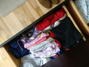 the lothes in the drawer should be neatly folded a la KonMari method, but instead they are a jumbled mess of semi-folded and wrinkled pj's.